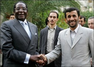 Mugabe and Ahmedinejad giving a handshake of evil